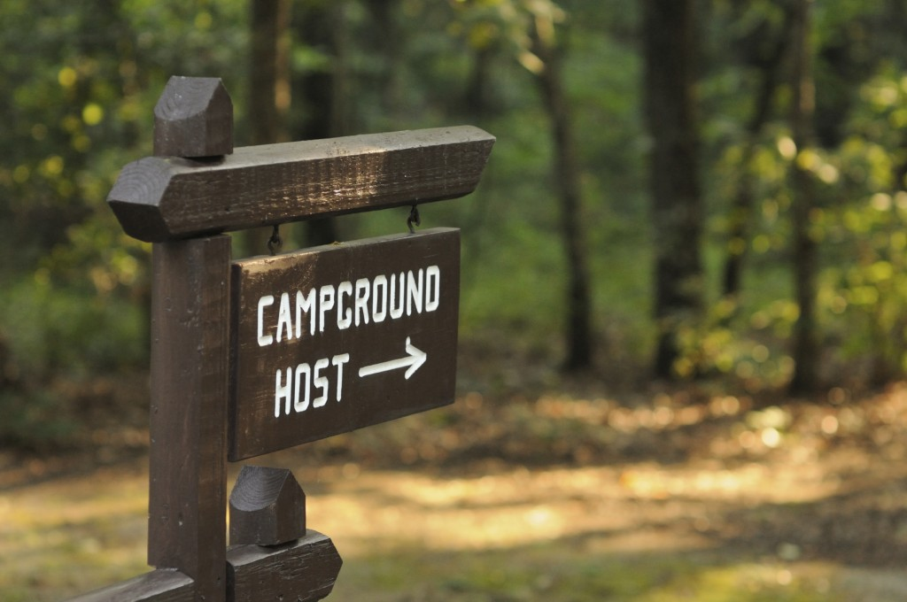 Camp host sign hanging in a campground