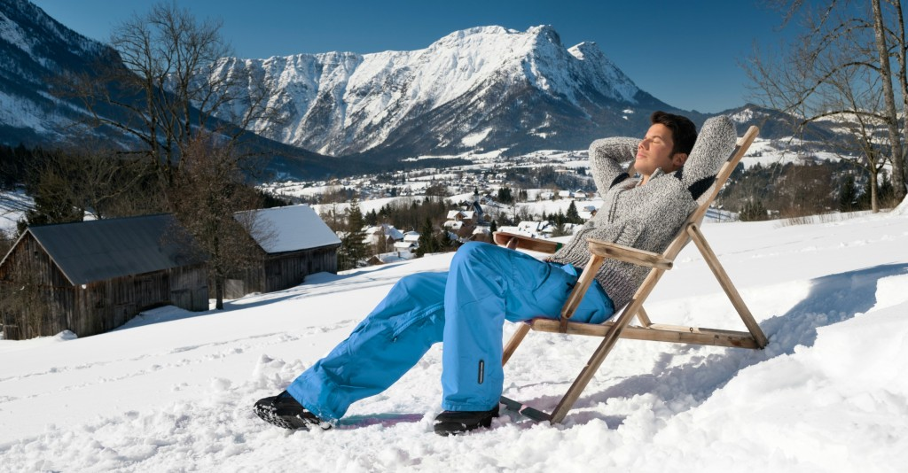 1Person relaxing in the sun with mountains behind