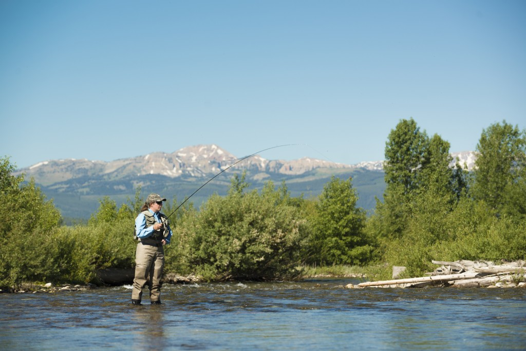 Woman fly fishing in a river