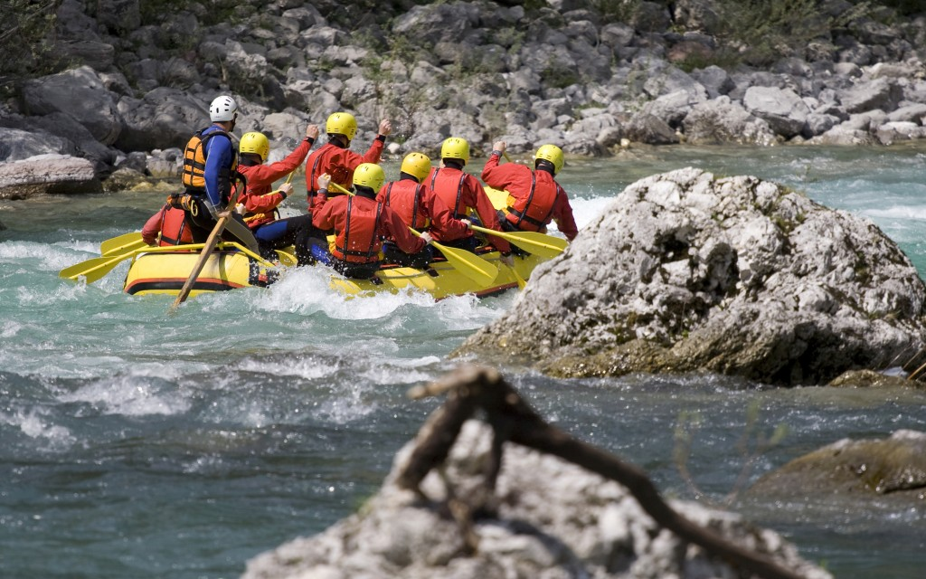 White water rafting guide with clients