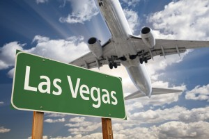 Las Vegas sign with plane flying over