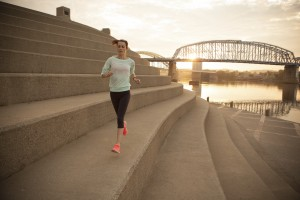 Person jogging in downtown cincinnati along the river