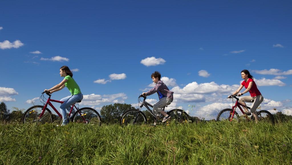 Family biking outdoors
