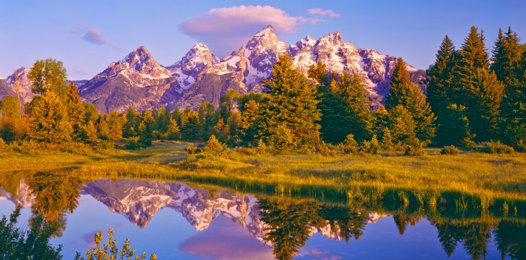 The Grand Tetons with reflection in water