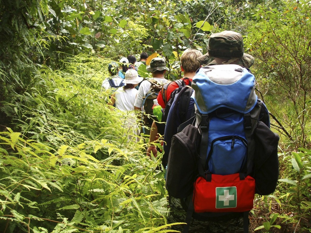 Hikers with first aid kit on backpack