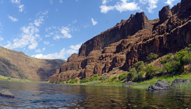 landscape of mountains and river on a sunny day on the John Day River in Oregon
